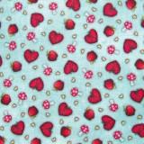 Tela patchwork Gorjuss My Story corazones, setas y manzanas sobre azul 1
